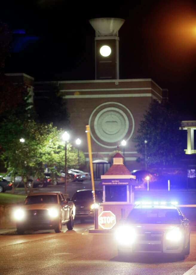 Police guard the main entrance to Tennessee State University while officials investigate the scene of a Thursday night shooting on the campus, Friday, Oct. 23, 2015, in Nashville, Tenn. Authorities say one person was killed and two others hospitalized in the shooting at an outdoor courtyard. A campus spokesperson said the person killed wasn't enrolled at the school. Photo: AP Photo/Mark Humphrey   / AP