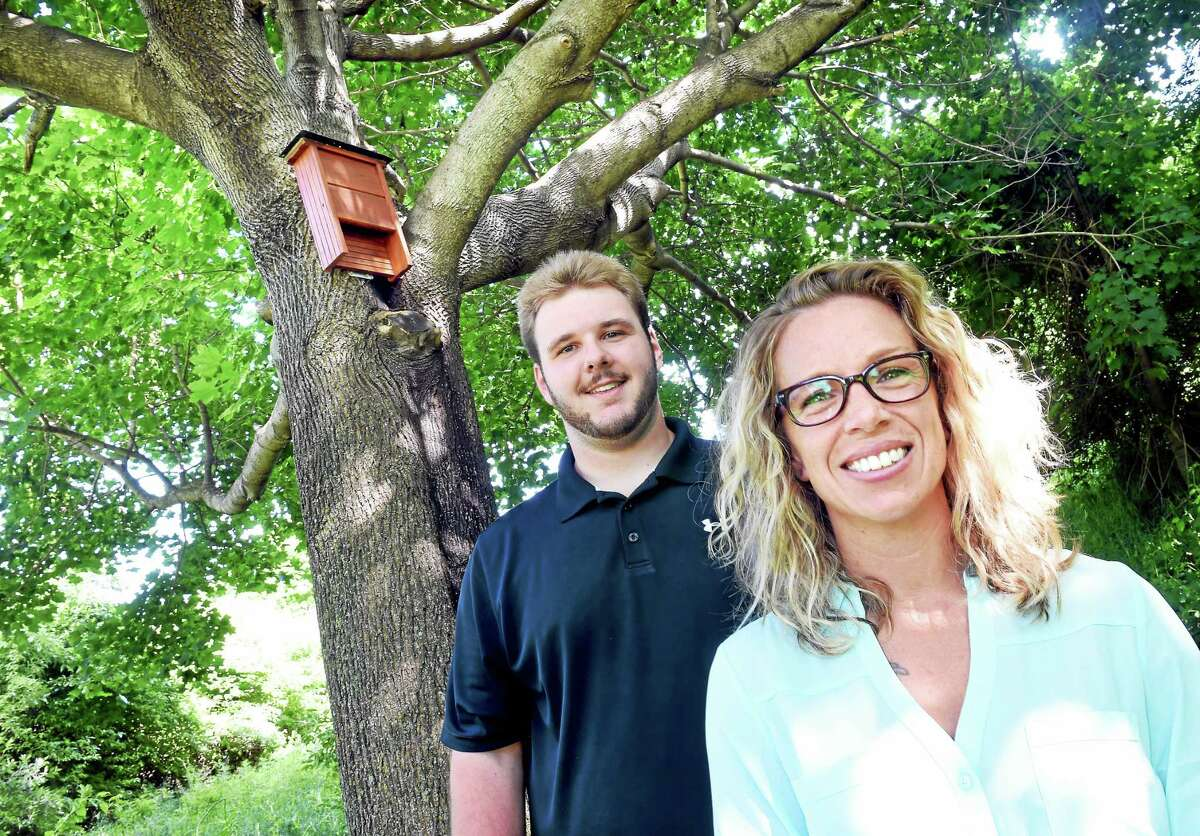 (Arnold Gold-New Haven Register) Biology Professor Miranda Dunbar (right) and Research Assistant Christopher Wisniewski are photographed are photographed in front of a bat house mounted on a tree on the grounds of Southern Connecticut State University in New Haven on 6/24/2015.