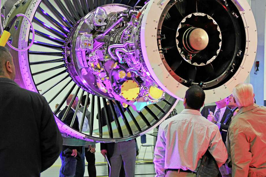 Visitors admire the PurePower PW1100G-JM engine for the Airbus A320neo at a ribbon-cutting on Wednesday at Pratt & Whitney in Middletown. Photo: Kathleen Schassler — The Middletown Press  / Kathleen Schassler All Rights