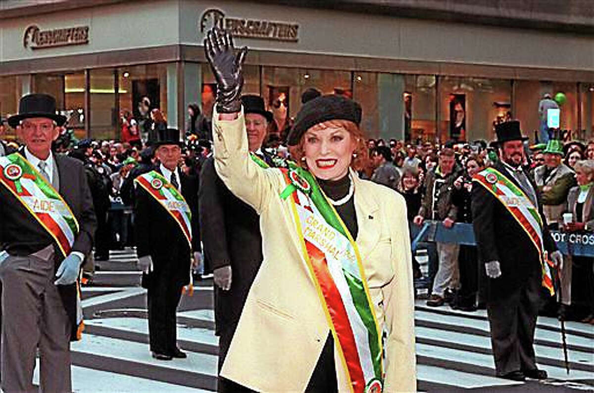 """In this March 17, 1999, file photo, St. Patrick's Day Parade Grand Marshal Maureen O'Hara waves to the people lined up along Fifth Avenue at the annual St. Patrick's Day Parade in New York. O'Hara,who appeared in such classic films as """"The Quiet Man? and How Green Was My Valley,"""" has died. Her manager says O?Hara died in her sleep Saturday, Oct. 24, 2015, at her home in Boise, Idaho."""