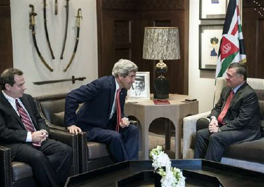 U.S. Ambassador to Jordan Stuart E. Jones, left, U.S. Secretary of State John Kerry, second left, and King Abdullah II of Jordan pose for photographers Jan. 5. Photo: AP / AFP POOL