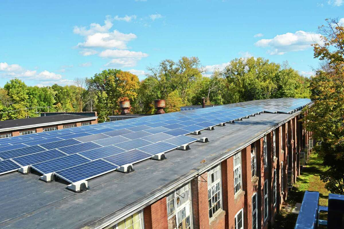Cassandra Day - The Middletown Press Middletown's Remington Rand building is outfitted with solar panels courtesy of Greenskies Renewable Energy. The town of Durham is working toward its own solar farm on Haddam Quarter Road.