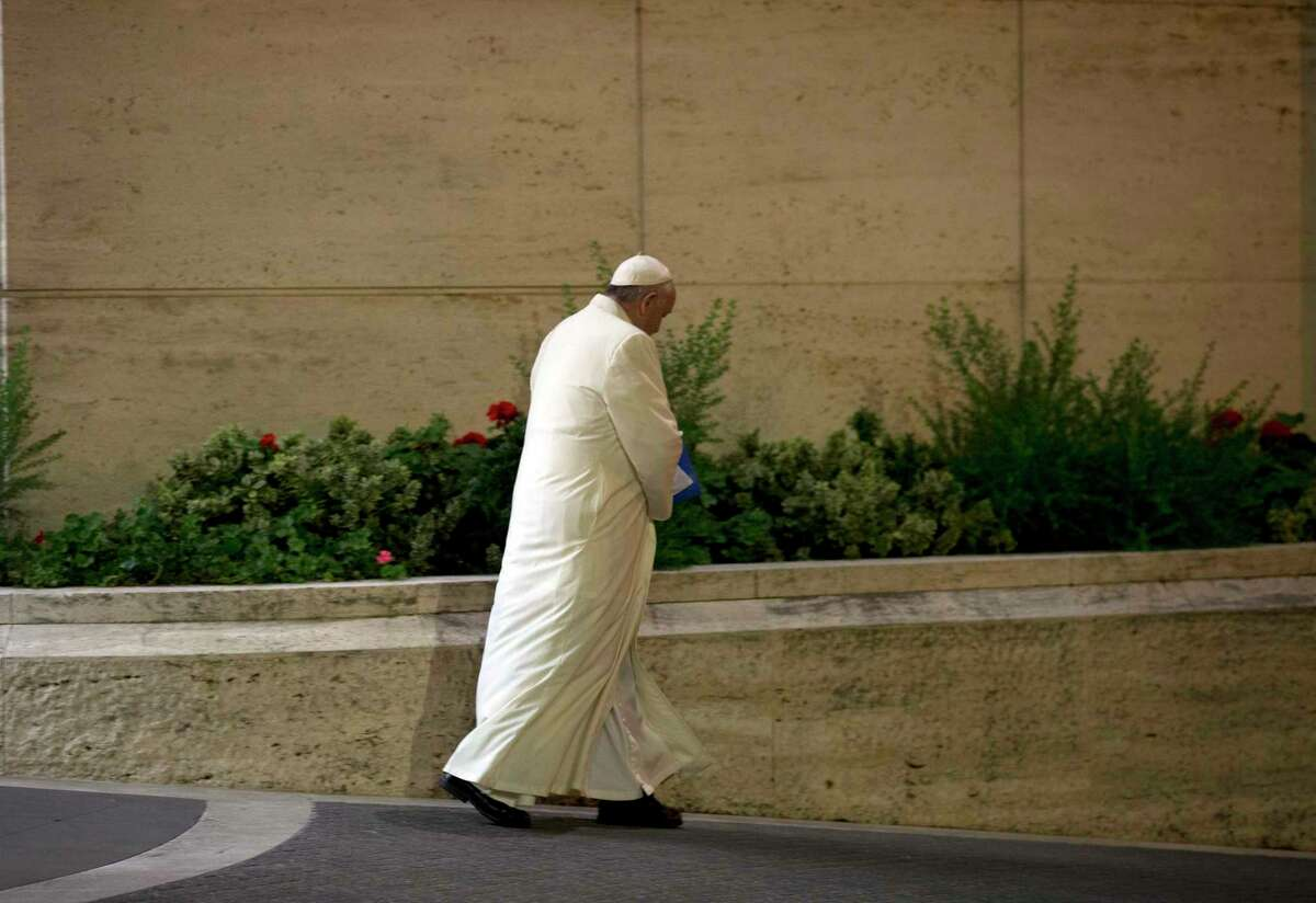 Pope Francis leaves at the end of the Synod of bishops, at the Vatican, Saturday, Oct. 24, 2015. Catholic bishops were voting Saturday on a final document to better minister to families following a contentious, three-week summit at the Vatican that exposed deep divisions among prelates over Pope Francis' call for a more merciful and less judgmental church.