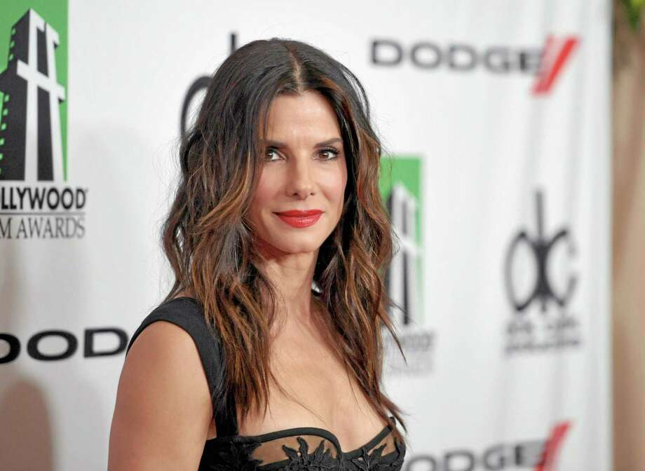 "FILE - In this Oct. 21, 2013 file photo, Sandra Bullock arrives at the 17th Annual Hollywood Film Awards Gala at the Beverly Hilton Hotel in Beverly Hills, Calif. Bullock scored five nominations for the People's Choice Awards airing on CBS, Wednesday, Jan. 8, 2014. The ""Gravity"" star is nominated for favorite comedic and dramatic actress and also gained two nominations for favorite duo. (Photo by John Shearer/Invision/AP, file) Photo: John Shearer/Invision/AP / Invision"