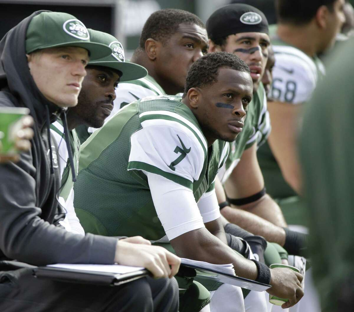 Jets quarterback Geno Smith (7) sits next to Michael Vick (1) during the first half of Sunday's game against the Bills.