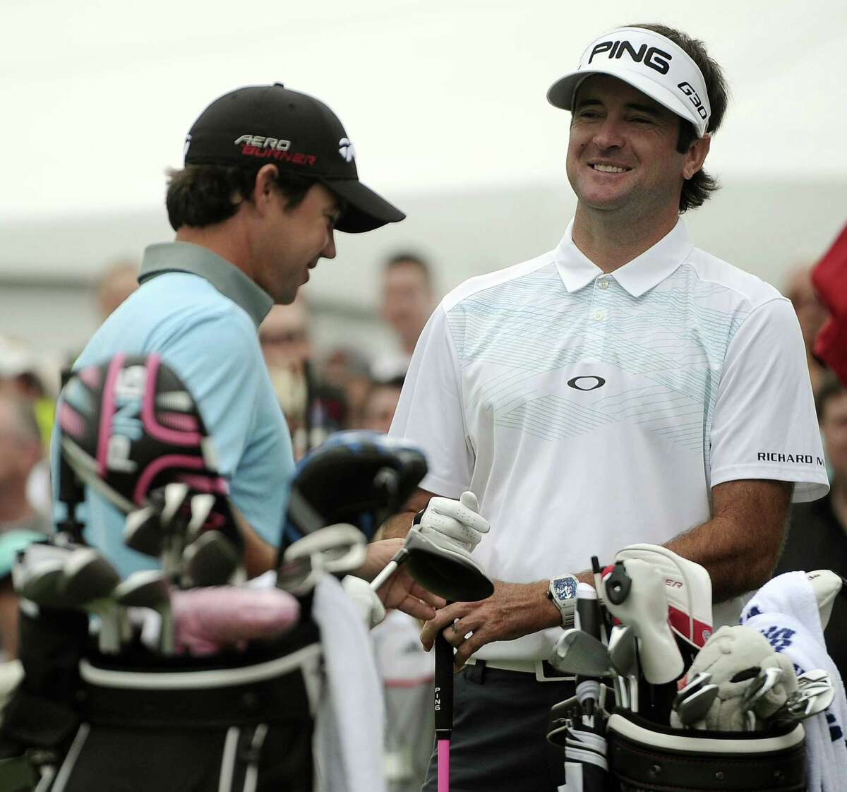 Bubba Watson, right, and Brian Harman stand on the first tee during the third round of the Travelers Championship on Saturday in Cromwell.