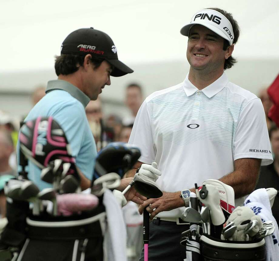Bubba Watson, right, and Brian Harman stand on the first tee during the third round of the Travelers Championship on Saturday in Cromwell. Photo: Jessica Hill — The Associated Press  / FR125654 AP
