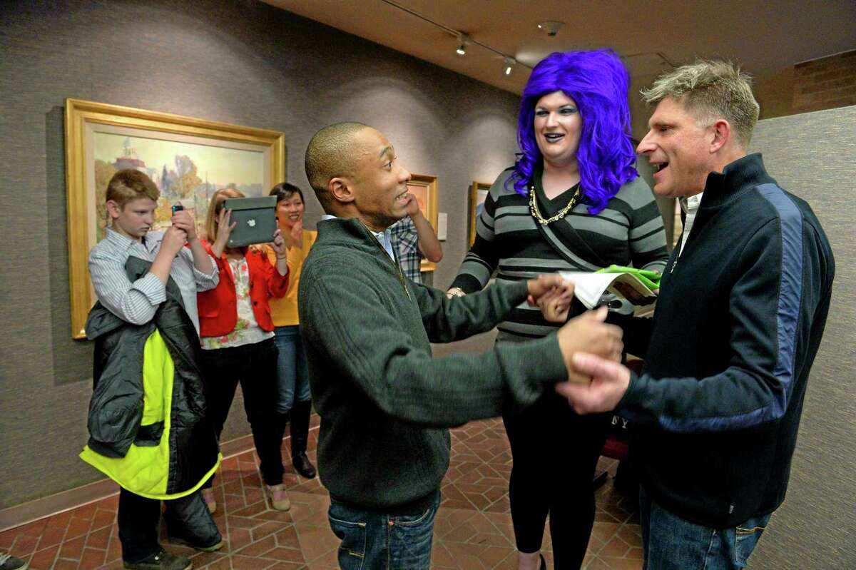 In this photo taken on Monday, Dec. 23, 2013, Greg Jaboin, left, expresses his excitement upon being declared married to his partner of 10-years, Steve Kachocki by officiant David Beach at the Salt Lake City County offices in Salt Lake City. The state plans to ask the U.S. Supreme Court to step in and put a halt to gay marriages while they appeal a federal judge's ruling overturning the ban. (AP Photo/The Salt Lake Tribune, Francisco Kjolseth) DESERET NEWS OUT; LOCAL TV OUT; MAGS OUT