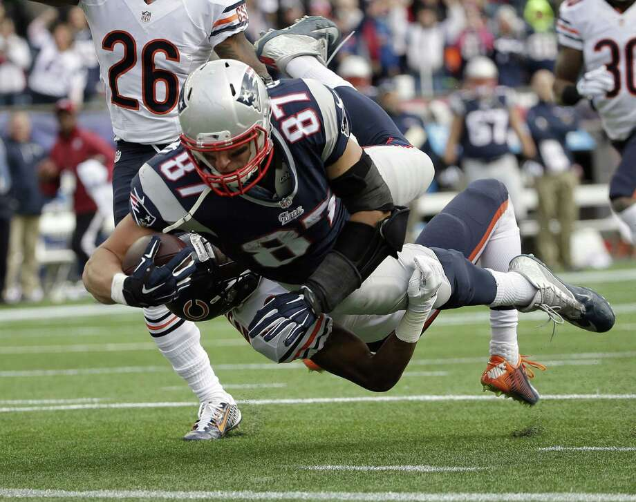 Patriots tight end Rob Gronkowski (87) carries Bears defensive back Al Louis-Jean (39) into the end zone while scoring a touchdown in the second half Sunday. Photo: Steven Senne — The Associated Press  / AP