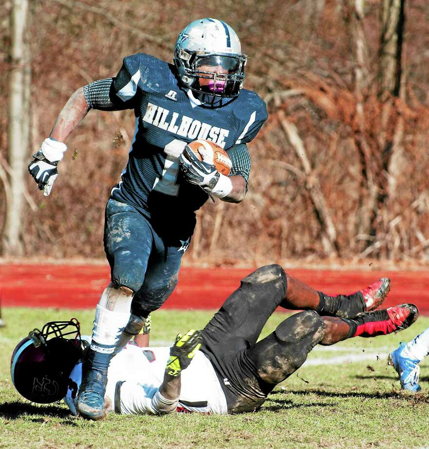 Hillhouse's Harold Cooper returns an interception during this past Thanksgiving's Elm City Bowl at Wilbur Cross. Cooper will take part in today's Super 100 Football Classic at Rentschler Field in East Hartford. Photo: VM Williams — Register File Photo