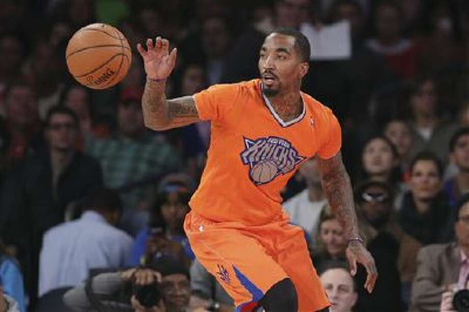 New York Knicks shooting guard J.R. Smith (8) eyes the ball during the first half of their NBA basketball game against the Oklahoma City Thunder at Madison Square Garden, Wednesday, Dec. 25, 2013, in New York. The Thunder defeated the Knicks 123-94. Photo: ASSOCIATED PRESS / AP2013