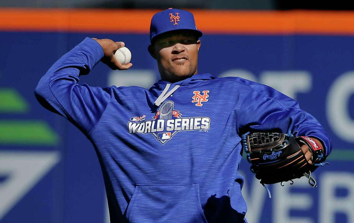 Mets closer Jeurys Familia throws in the outfield during a voluntary workout on Friday in New York.