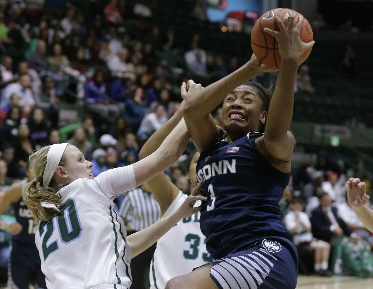 UConn forward Morgan Tuck goes to the basket as Tulane guard Danielle Blagg reaches in during the second half of the top-ranked Huskies' 94-47 win on Monday night in New Orleans.
