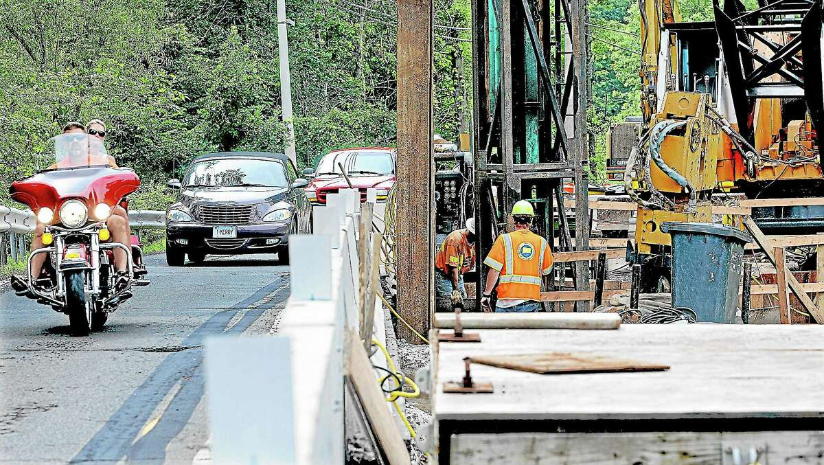 Motorists share one lane as construction continues on a new bridge along Route 147 in Middlefield in this file photo.