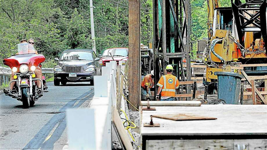 Motorists share one lane as construction continues on a new bridge along Route 147 in Middlefield in this file photo. Photo: Catherine Avalone — The Middletown Press   / TheMiddletownPress