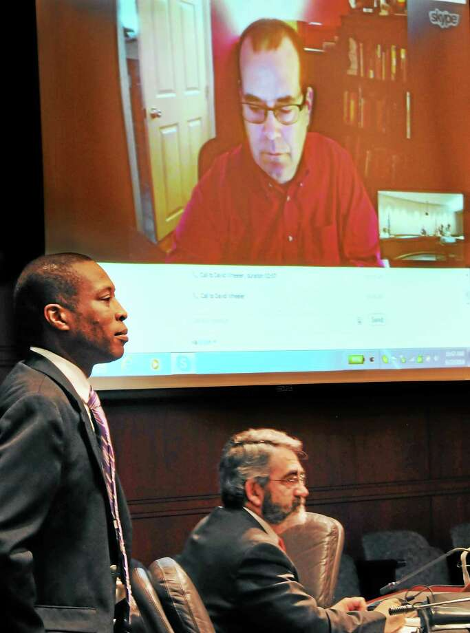 Hamden Mayor Scott Jackson, and University of New Haven Professor, Wayne Sanford, prepare to hear remarks by David Wheeler, father of Sandy Hook shooting victim, Benjamin Wheeler. Wheeler is communicating through Skype to Gov. Dannel Malloy's Sandy Hook Advisory Commission Friday. Photo: Melanie Stengel — New Haven Register