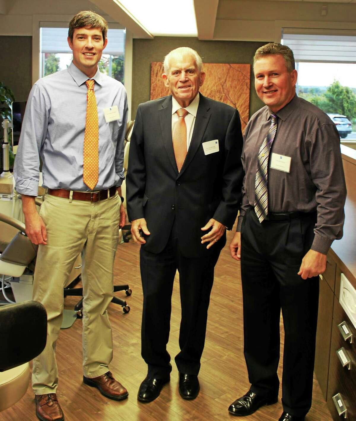 Conroy Orthodontics recently held an open house in its new Middletown location. From left are Dr. Doug H. MacGilpin, Chamber President Larry McHugh and Dr. John J. Conroy.