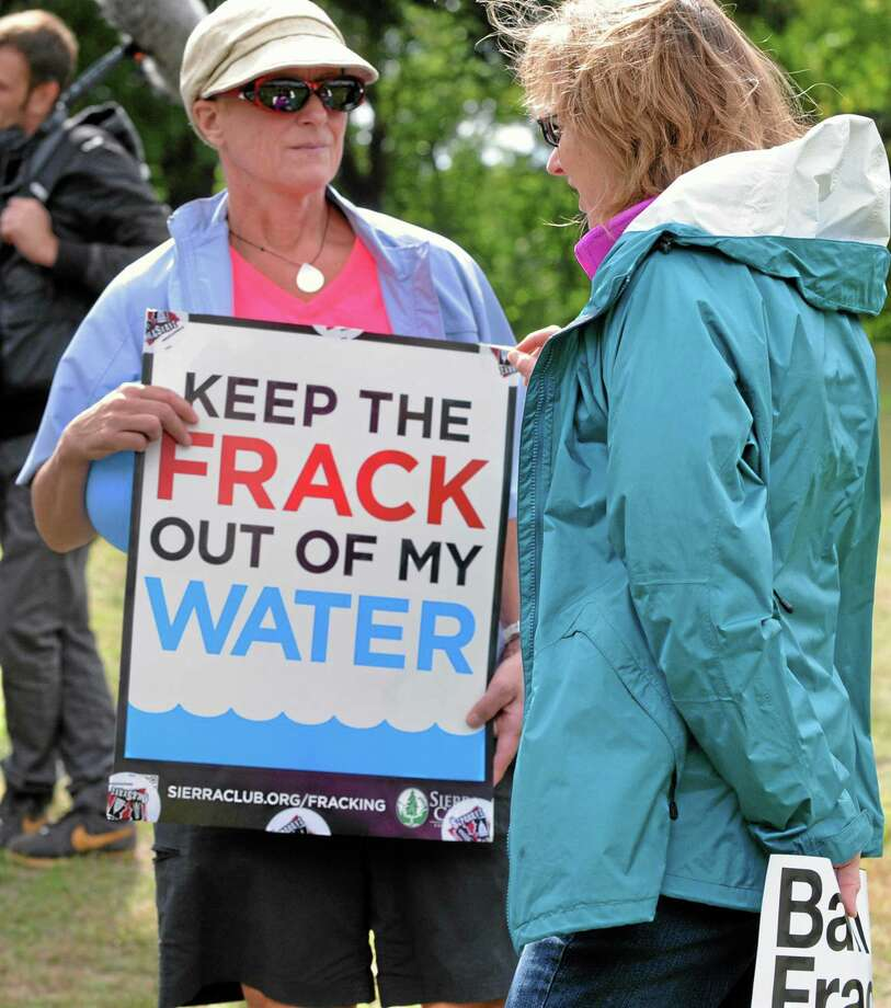 FILE--In this Sept. 22, 2012 file photo, environmental protection groups participate in a global Frackdown Day in PIttsburgh, calling for a moratorium on Shale Gas Drilling and the hydraulic fracturing process. Pennsylvania officials say there have been 370 complaints so far in 2013 alleging that oil or natural gas drilling polluted or diminished the flow of water to private water wells. But The Associated Press found that a lack of detail in the data make it almost impossible to judge whether the drilling boom is harming more individuals than in the past, or less. (AP Photo/John Heller, File) Photo: AP / FR48174 AP