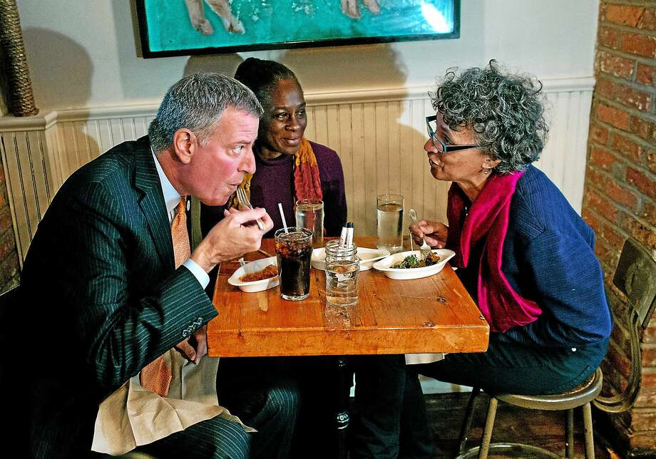 From left, New York City Mayor Bill de Blasio, wife Chirlane McCray, and New York City Health Commissioner Dr. Mary Bassett have a meal at The Meatball Shop in New York on Oct. 25, 2014. Dr. Craig Spencer, an Ebola patient, ate there just before he became ill. Photo: AP Photo/Craig Ruttle  / FR61802 AP