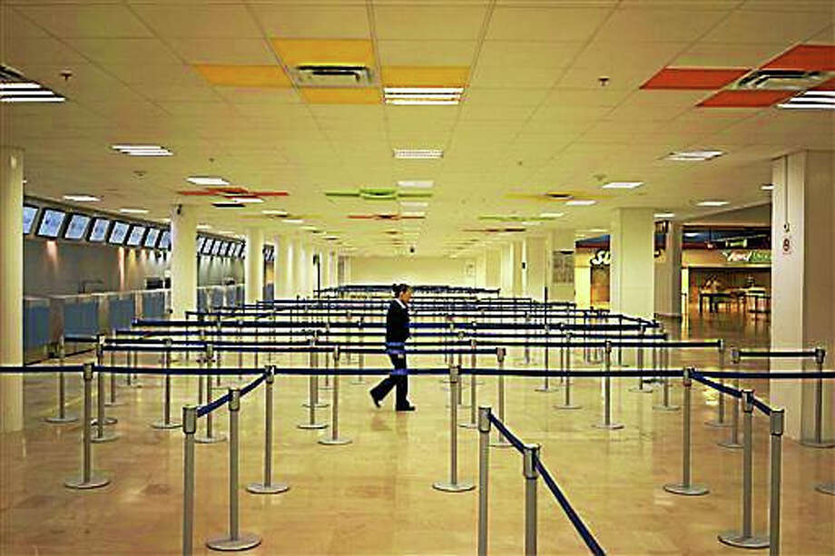 """An airline employee walks in the empty airport where all flights are canceled as Hurricane Patricia approaches the Pacific resort city of Puerto Vallarta, Mexico, Friday. Oct. 23, 2015. Patricia headed toward southwestern Mexico Friday as a monster Category 5 storm, the strongest ever in the Western Hemisphere that forecasters said could make a """"potentially catastrophic landfall"""" later in the day. Photo: AP Photo/Cesar Rodriguez   / AP"""