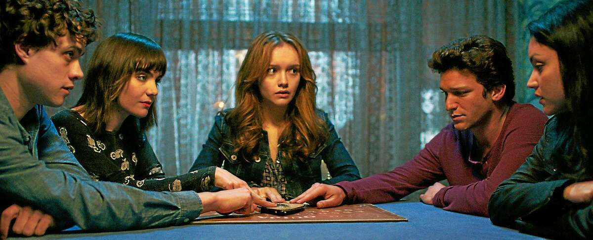 """A group of teenage friends attempts to communicate with a dead friend using a board game in the horror movie """"Ouija."""""""