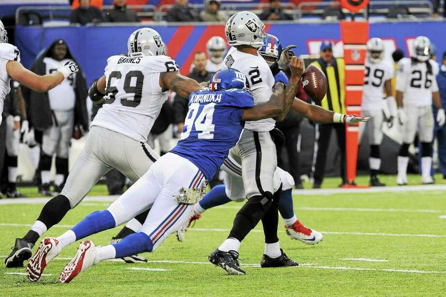 The New York Giants released defensive end Mathias Kiwanuka on Tuesday. Photo: Bill Kostroun — The Associated Press  / FR51951 AP