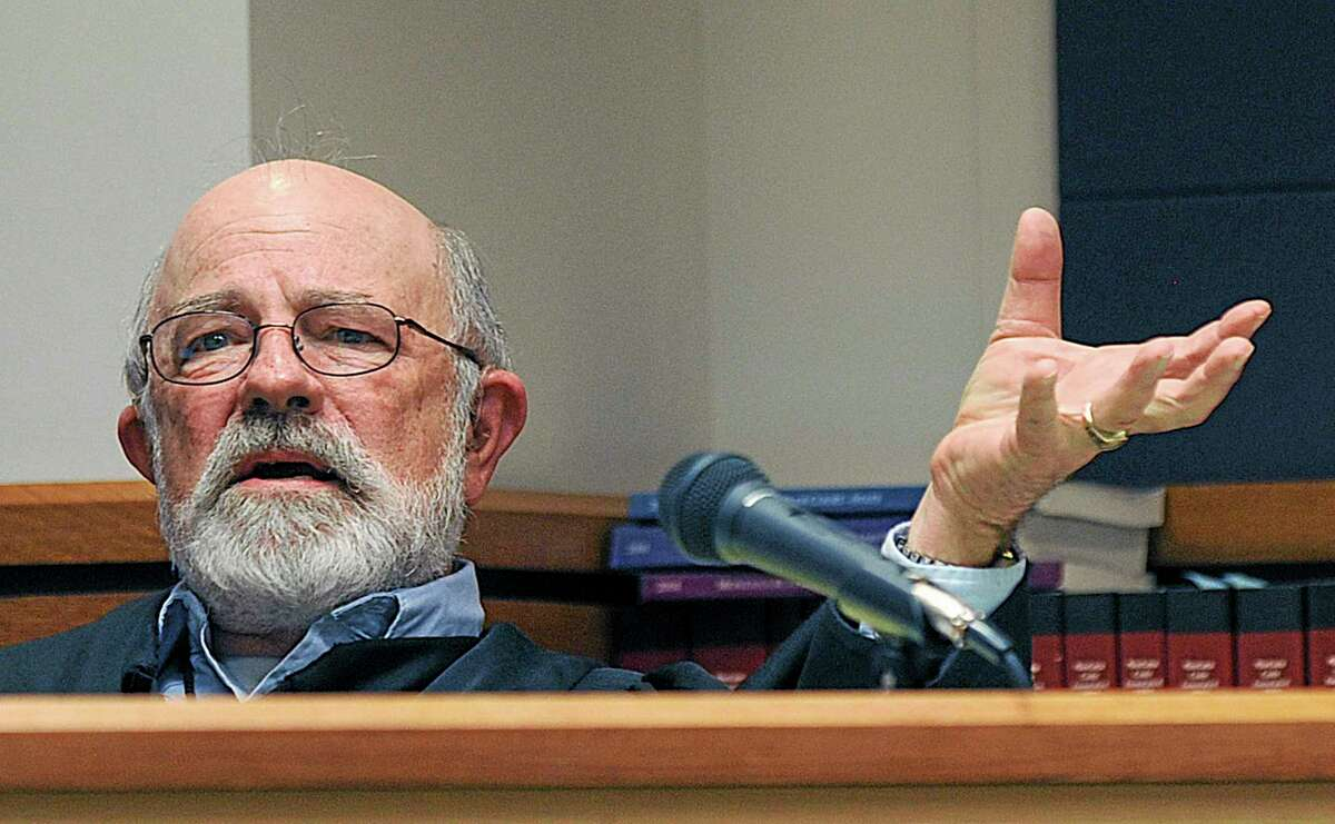 """FILE - In this undated file photo, District Judge G. Todd Baugh presides at a hearing in Great Falls, Mont. JudgeBaugh, facing suspension for saying a 14-year-old rape victim appeared """"older than her chronological age"""" says he believes the penalty isn't warranted. Baugh proposed Friday, June 27, 2014, in a written response to the Montana Supreme Court that it withdraw its order for a 31-day suspension. Baugh suggested the court relied on incomplete media reports in deciding the punishment. (AP Photo/Billings Gazette, Larry Mayer, File)"""