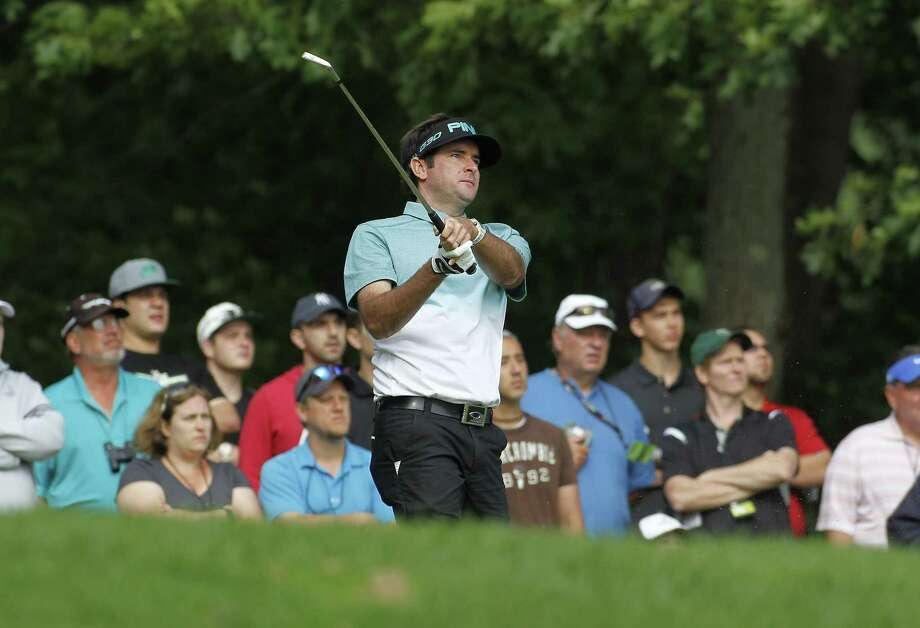 Leader Bubba Watson watches his tee shot on the 11th hole during the second round of the Travelers Championship on Friday in Cromwell. Photo: Stew Milne — The Associated Press  / FR56276 AP