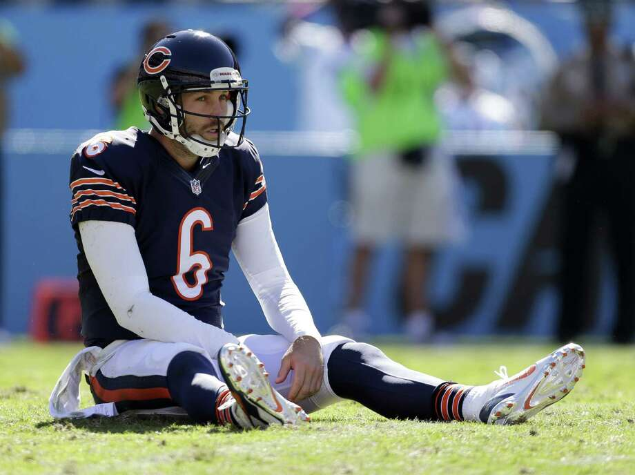 Jay Cutler and the Bears haven't had much success at home but are 3-1 on the road this season. They face the Patriots in Foxborough on Sunday. Photo: The Associated Press File Photo  / FR170480 AP