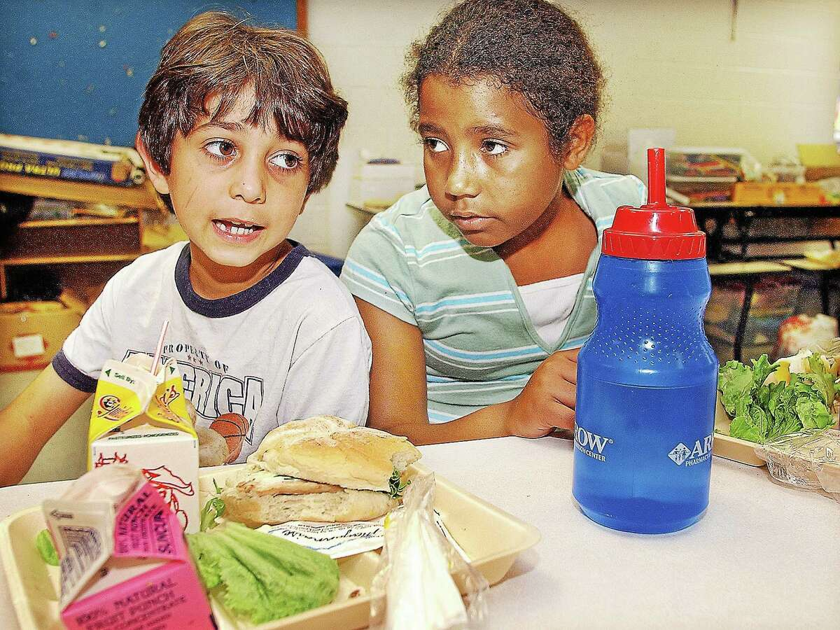 Catherine Avalone - The Middletown Press ¬ Students enjoy the free lunch program Macdonough Elementary School in Middletown in this file photo.