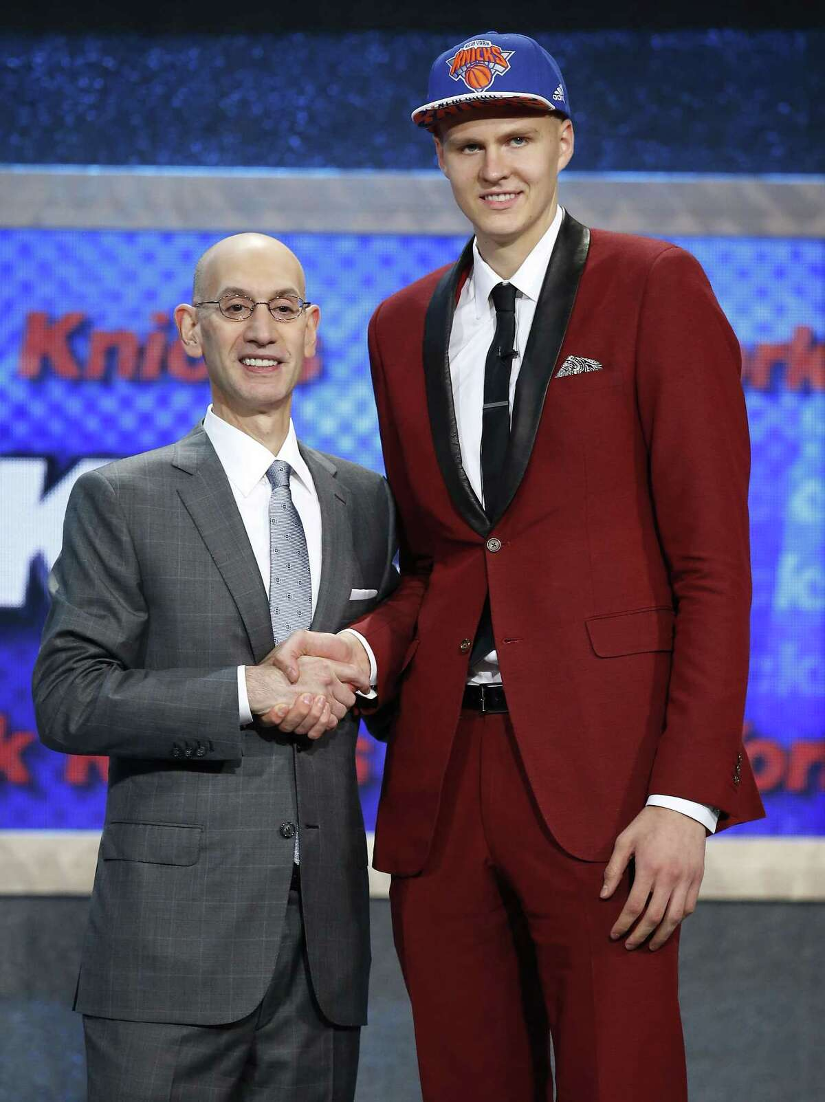 Kristaps Porzingis, right, poses for a photo with NBA Commissioner Adam Silver after being selected fourth overall by the New York Knicks during the NBA Draft on Thursday in New York.