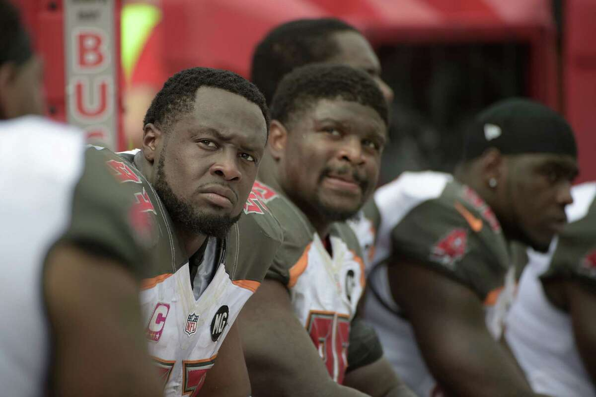 Tampa Bay Buccaneers defensive tackle Gerald McCoy, left, watches from the bench during the first half of an Oct. 12 game against the Baltimore Ravens in Tampa, Fla.