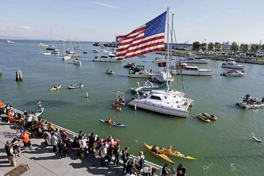 Boats are seen in San Francisco's McCovey Cove outside AT&T Park before Game 3 of the World Series between the Kansas City Royals and the Giants on Friday. Photo: Eric Risberg — The Associated Press  / AP