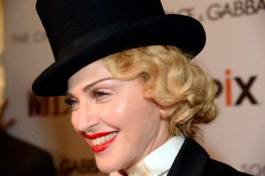 Madonna attends the Dolce & Gabbana and The Cinema Society screening of the Epix World premiere of 'Madonna: The MDNA Tour' at The Paris Theatre on June 18, 2013 in New York City. Photo: WireImage / 2013 Kevin Mazur