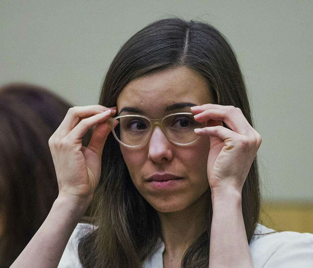 Jodi Arias adjusts her glasses during her sentencing retrial at Maricopa County Superior Court, Wednesday, Feb. 18, 2015, in Phoenix. Arias was convicted of first-degree murder in May 2013 in the 2008 killing of former boyfriend Travis Alexander. However, jurors deadlocked on her punishment. (AP Photo/The Arizona Republic, Tom Tingle, Pool)