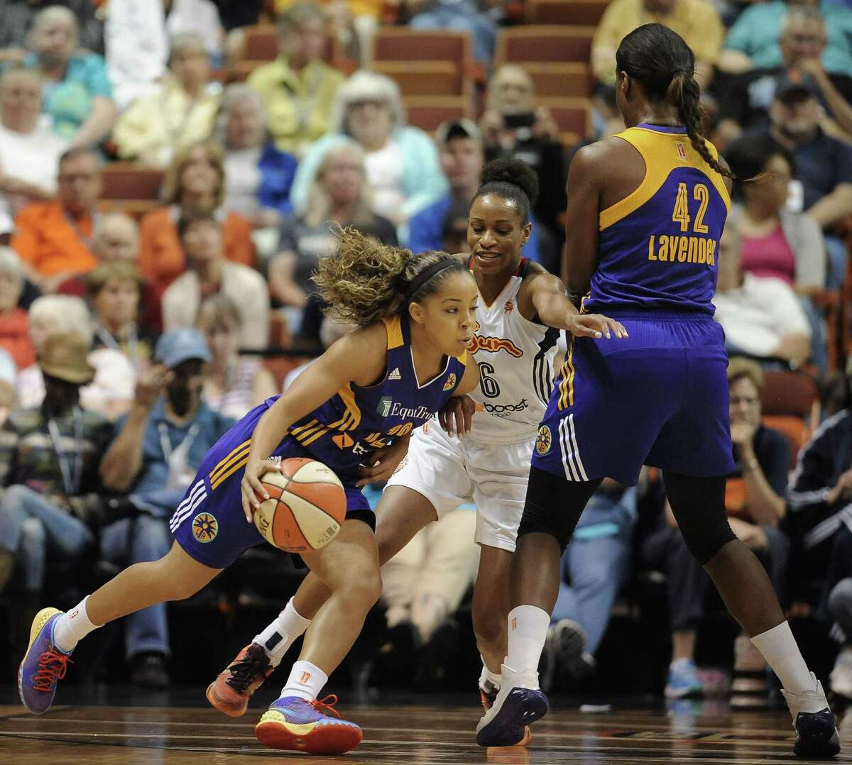 Los Angeles Sparksí Jasmine Lister, left, dribbles around Connecticut Sunís Jasmine Thomas, center, as Sparksí Jantel Lavender sets a pick during the first half of a WNBA basketball game, Friday, June 26, 2015, in Uncasville, Conn. (AP Photo/Jessica Hill)