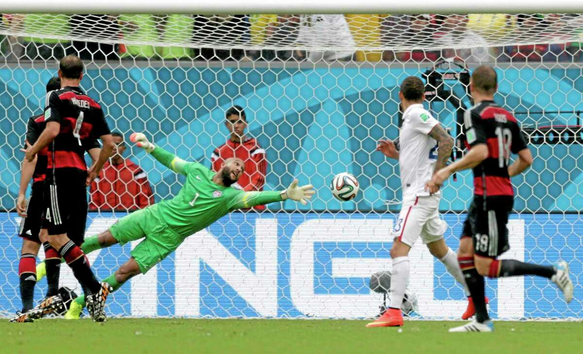 United States goalkeeper Tim Howard can not stop a shot by Germany's Thomas Mueller to score his side's first goal during a Group G World Cup match Thursday at the Arena Pernambuco in Recife, Brazil.
