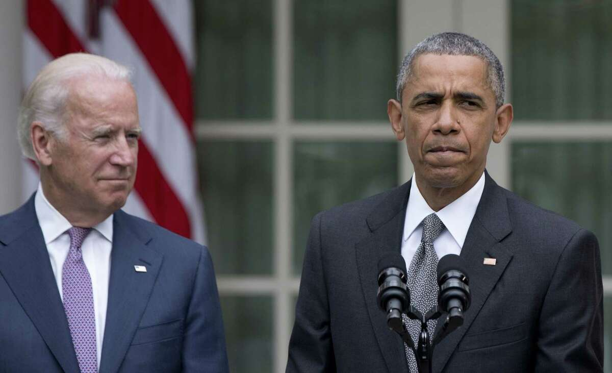 President Barack Obama, joined by Vice President Joe Biden, pauses as he speaks in the Rose Garden of the White House, Thursday, June 25, 2015, in Washington, about that the U.S. Supreme Court upheld the subsidies for customers in states that do not operate their own exchanges under President Barack Obama's Affordable Care Act. (AP Photo/Carolyn Kaster)