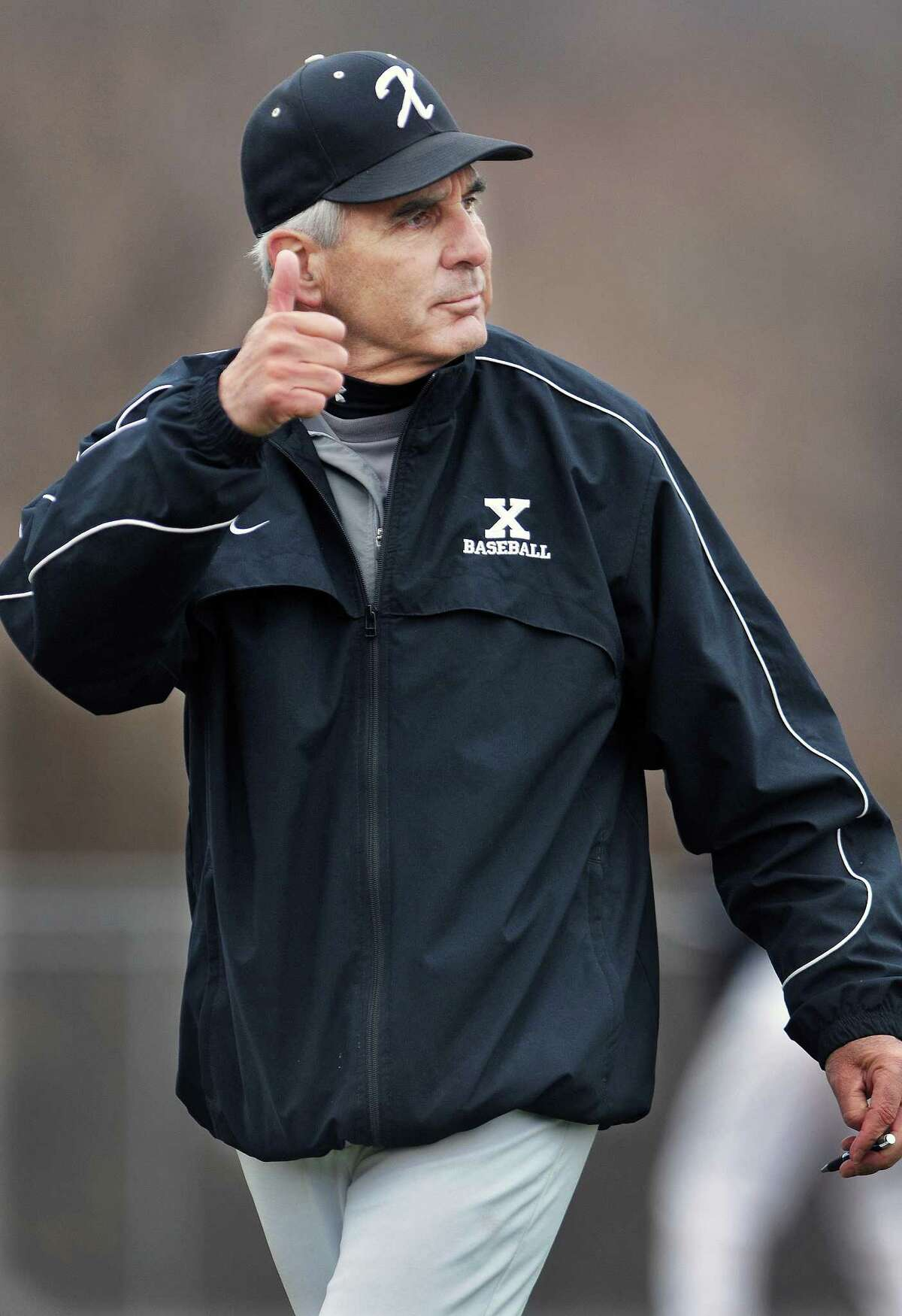 Catherine Avalone - The Middletown Press Xavier head coach, Rich Magner gives the thumbs up sign during a game in April 2011. Magner retired after 35 seasons with the Falcons.