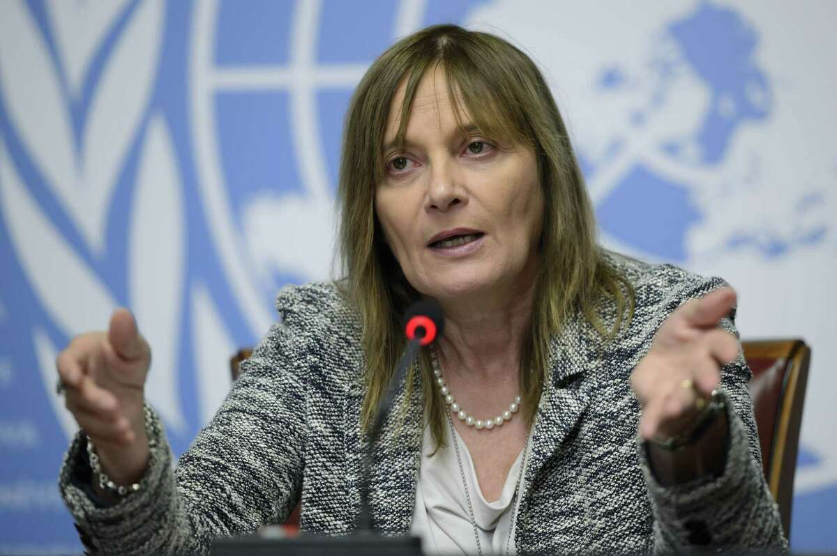 Marie-Paule Kieny, Assistant Director General for Health Systems and Innovation of the World Health Organization (WHO), speaks during a press conference at the European headquarters of the United Nations in Geneva, Switzerland, Tuesday, Oct. 21, 2014. Dr Marie-Paule Kieny, says clinical trials planned or under way in Europe, Africa and the U.S. are being accompanied by a strong push among governments for immediate ìreal-world useî of an approved Ebola vaccine. She told reporters Tuesday in Geneva that tens of thousands of doses _ short of mass deployment _ would be made available through West African ìefficacy trialsî starting ìin early 2015, in January.î (AP Photo/Keystone,Martial Trezzini)