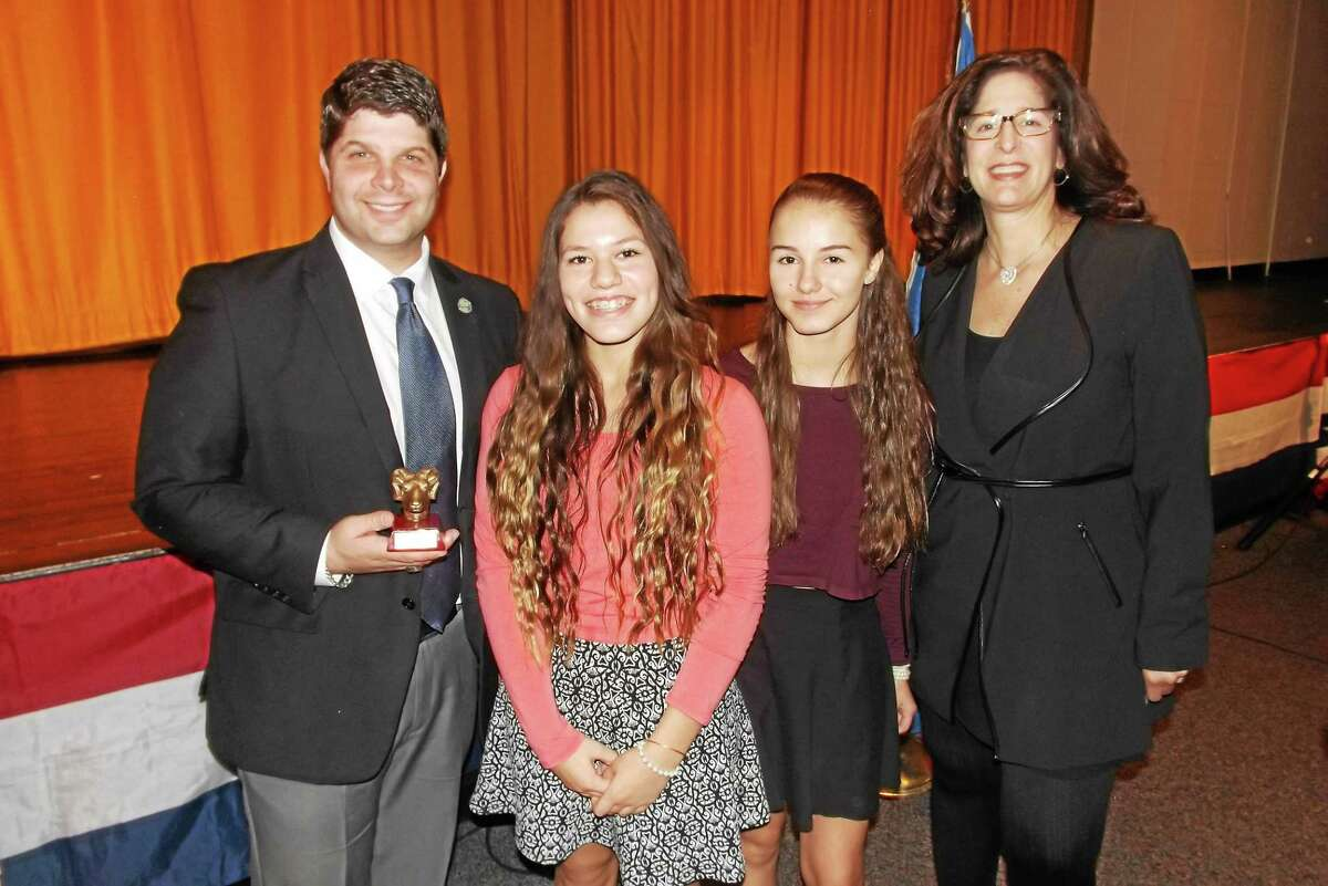 Mayor Dan Drew and his Republican challenger, Middletown Common Councilwoman Sandra Russo-Driska, debated at Woodrow Wilson Middle School on Friday. Between them, from left, are Student Council President Monica Flores, and Vice President Emily Meeker, both eighth-graders.