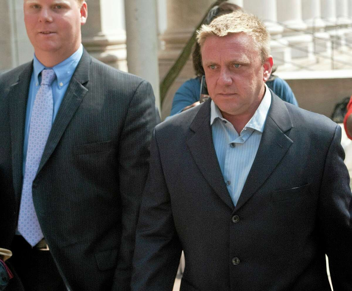 In this July 26, 2012 photo, Paul Rogers, right, leaves federal court in New Haven, Conn., after a hearing about his role in funneling illegal campaign donations to former House Speaker Chris Donovan's former campaign manager. Rogers is scheduled to be sentenced Wednesday, Jan. 8, 2013, in federal court in New Haven, after pleading guilty to devise a scheme to bribe a public official and conspiring to make false statements. (AP Photo/Republican-American, Jim Shannon )