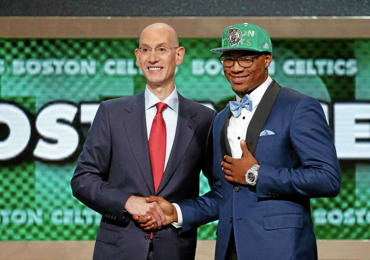 Oklahoma State's Marcus Smart, right, poses for a photo with NBA commissioner Adam Silver after being selected sixth overall by the Boston Celtics Thursday.