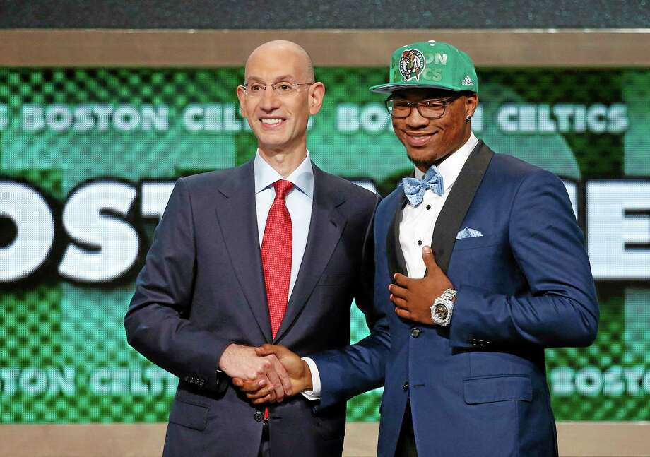 Oklahoma State's Marcus Smart, right, poses for a photo with NBA commissioner Adam Silver after being selected sixth overall by the Boston Celtics Thursday. Photo: Jason DeCrow — The Associated Press  / FR103966 AP