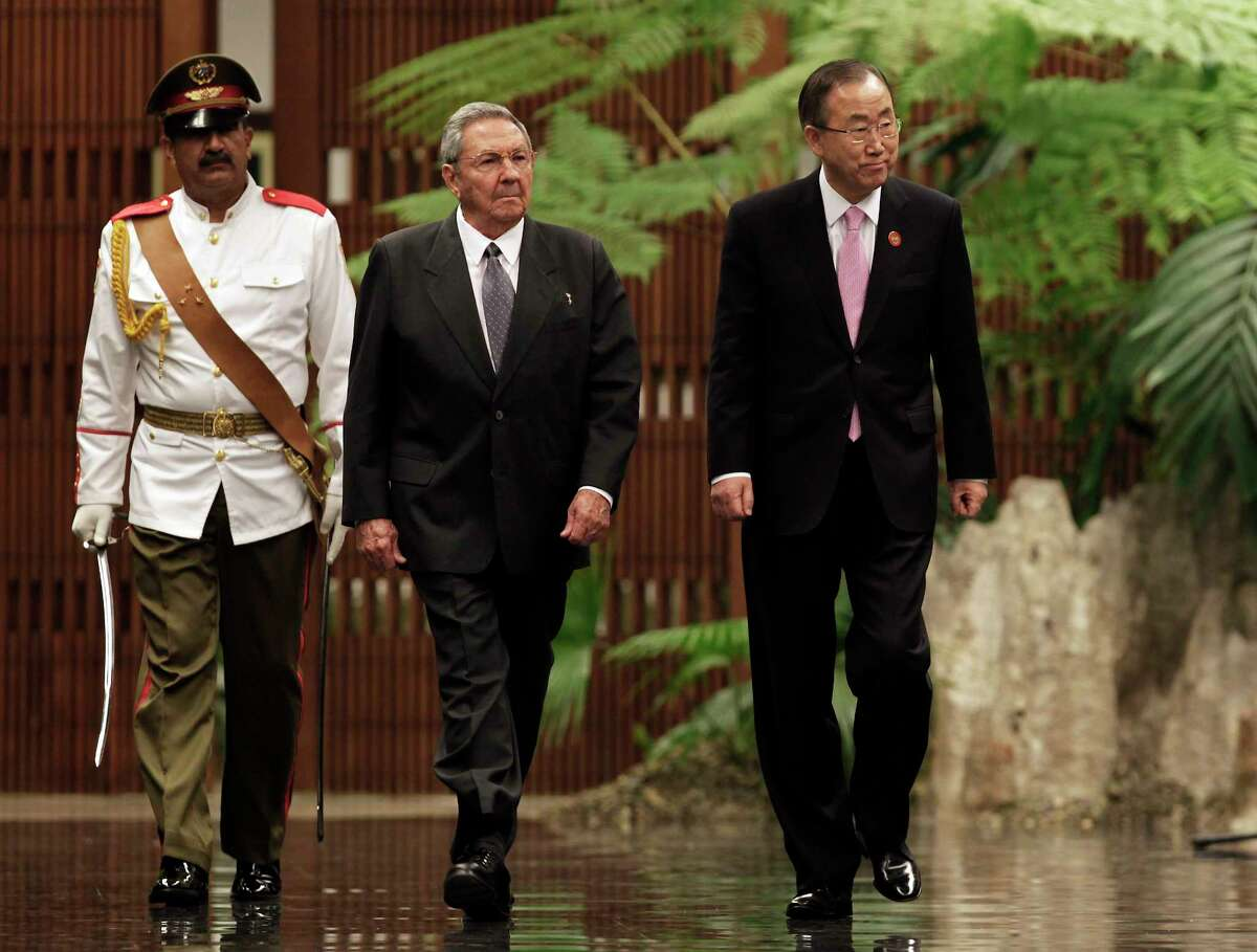 Cuba's President Raul Castro, left center, and U.N. Secretary General Ban Ki-moon, right, review an honor guard at the Revolutionary Palace in Havana, Cuba, in this Jan. 27, 2014, photo.