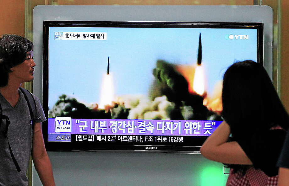 People watch a TV news program showing the missile launch conducted by North Korea, at Seoul Railway Station in Seoul, South Korea on June 26, 2014. North Korea fired three short-range projectiles Thursday into the waters off its east coast, a South Korean defense official said. Photo: AP Photo/Ahn Young-joon  / AP