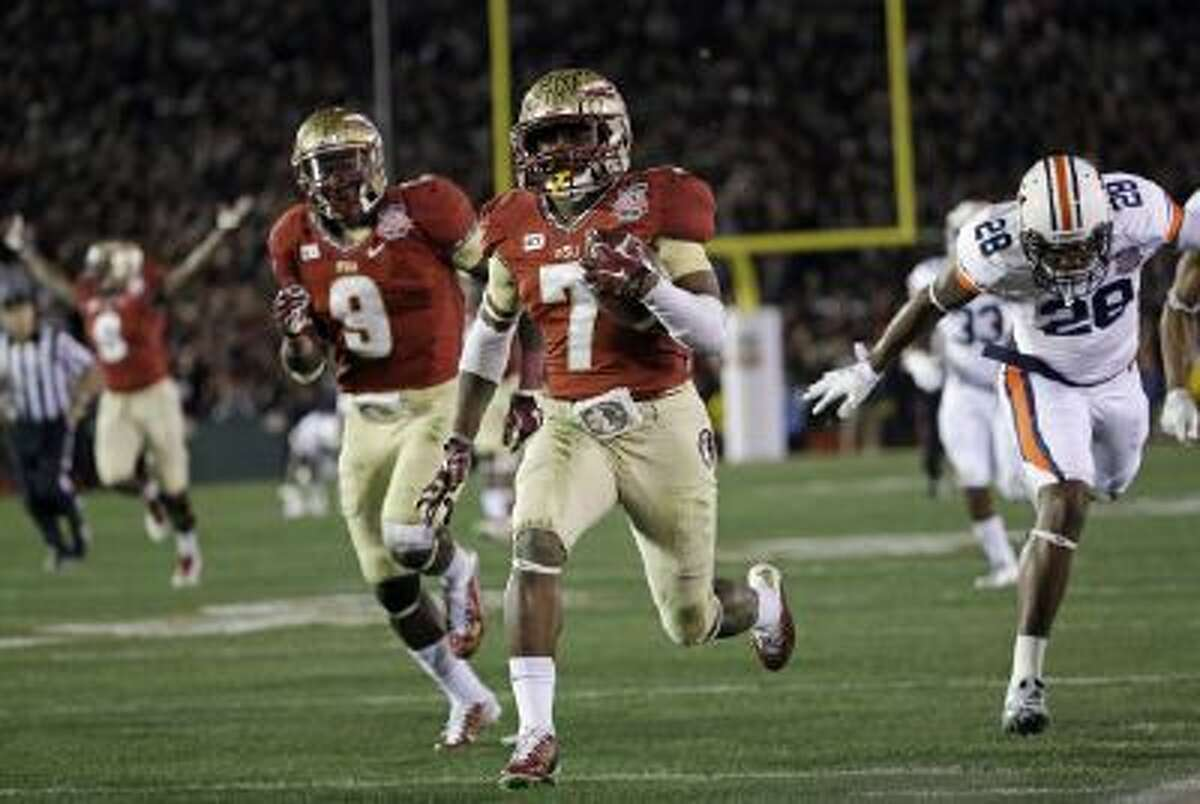 Florida State's Levonte Whitfield (7) runs back a kickoff for a touchdown during the fourth quarter Monday.