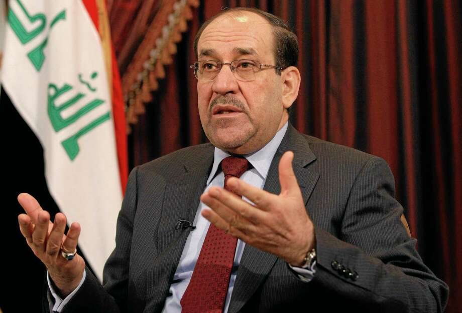 FILE - This Dec. 3, 2011 file photo shows Iraq's Shiite Prime Minister Nouri al-Maliki talks during an interview with The Associated Press in Baghdad, Iraq. The prospect of the U.S. military returning to the fight in Iraq has turned congressional hawks into doves. Lawmakers who eagerly voted to authorize military force 12 years ago to oust Saddam Hussein and destroy weapons of mass destruction that were never found now harbor doubts that air strikes will turn back insurgents threatening Prime Minister Nouri al-Maliki's government and Baghdad. (AP Photo/Hadi Mizban, File) Photo: AP / AP