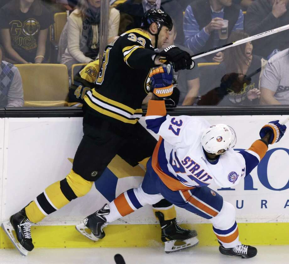 New York Islanders defenseman Brian Strait (37) collides with Bruins defenseman Zdeno Chara during the first period of Thursday night's game in Boston. Photo: Charles Krupa — The Associated Press  / AP