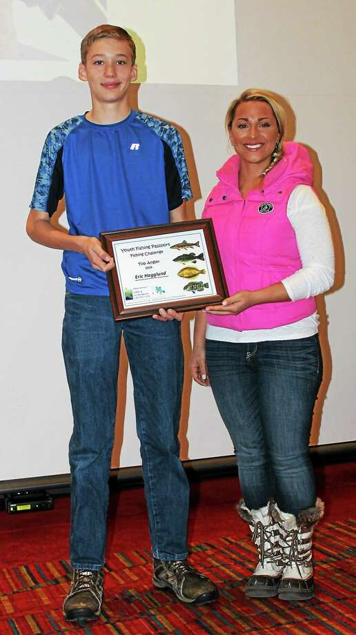 Eric Hagglund of Middletown, left, is among the 2014 youth fishing challenge top angler award winners. He's pictured with Andrea Repko, the photo contest winner for the cover of the 2014 Connecticut Angler's Guide published by the state Department of Energy and Environmental Protection. Photo: Courtesy Photo